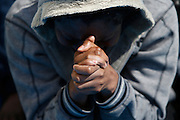 A migrant prays on the Migrant Offshore Aid Station (MOAS) ship Topaz Responder after being rescued around 20 nautical miles off the coast of Libya, June 23, 2016.  Picture taken June 23, 2016.<br /> REUTERS/Darrin Zammit Lupi <br /> MALTA OUT. NO COMMERCIAL OR EDITORIAL SALES IN MALTA
