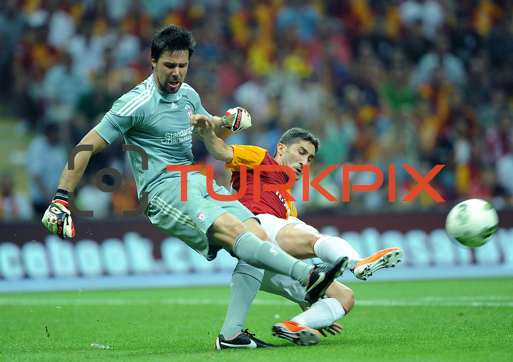 Galatasaray's Sabri SARIOGLU (R) and Liverpool's goalkeeper DONI (L) during their Friendly soccer match Galatasaray between Liverpool at the TT Arena at Arslantepe in Istanbul Turkey on Saturday 28 July 2011. Photo by TURKPIX