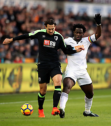 AFC Bournemouth's Charlie Daniels (left) and Swansea City's Wilfried Bony battle for the ball during the Premier League match at the Liberty Stadium, Swansea.