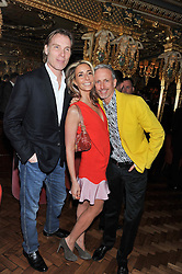 Left to right, DAMIAN ASPINALL, TARA BERNERD and PATRICK COX at the 50th birthday party for Patrick Cox held at the Café Royal Hotel, 68 Regent Street, London on 15th March 2013.