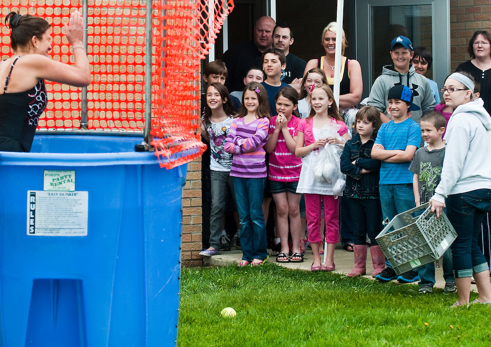 Matt Dixon   The Flint Journal..Kids react after dunking one of their teachers during the annual Fun Fair at West Shore Elementary school in Fenton Saturday afternoon. The fair is put on by parent volunteers from West Shore Elementary and Torrey Hill Intermediate School and serves as a fundraiser for both schools.
