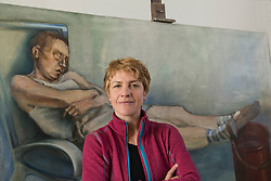 Portrait of an female artist in front of a painting, Bavaria, Germany