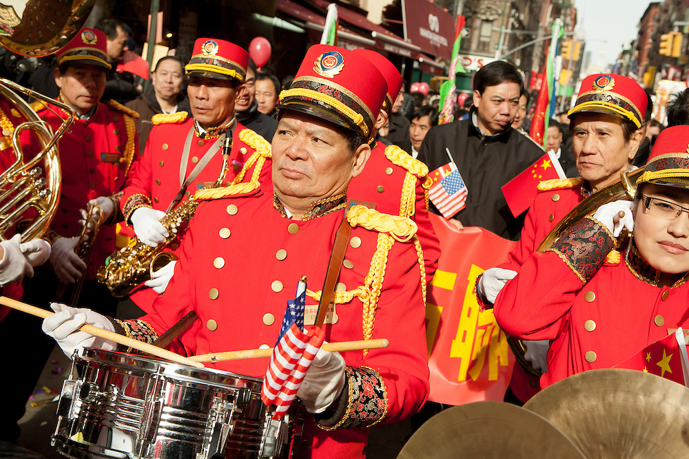 A snare drummer in one of several marching bands in the parade.