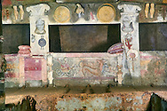 Interior of the Tomb of Reliefs that has everyday Etruscan objects carved into the volcanc Tuff rock, as well as separate burial chambers with rock pillows, the freeze below the burial niche depicts the gods of the underworld, Scilla and her three headed dog cerberus, 4th century BC, Necropoli della Banditaccia, Cerveteri, Italy. A UNESCO World Heritage Site .<br /> <br /> Visit our ETRUSCAN PHOTO COLLECTIONS for more photos to buy as buy as wall art prints https://funkystock.photoshelter.com/gallery-collection/Pictures-Images-of-Etruscan-Historic-Sites-Art-Artefacts-Antiquities/C0000GgxRXWVMLyc