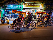 26 DECEMBER 2017 - HANOI, VIETNAM: Tourists on an evening pedicab tour of the Old Quarter of Hanoi.      PHOTO BY JACK KURTZ