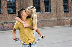 Teenage couple kissing each other