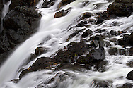 Detail of the water flowing over the Upper Englishman River Falls in Englishman River Falls Provincial Park near Nanaimo, British Columbia, Canada