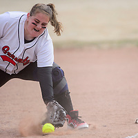 031715       Cable Hoover<br /> <br /> Grants Pirate Kali Bratzel (23) stops a Thoreau Hawks hit at first base Tuesday in Grants.