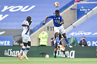 LEICESTER, ENGLAND - JULY 04: Kelechi Iheanacho of Leicester City heads clear from Cheikhou Kouyate of Crystal Palace during the Premier League match between Leicester City and Crystal Palace at The King Power Stadium on July 4, 2020 in Leicester, United Kingdom. Football Stadiums around Europe remain empty due to the Coronavirus Pandemic as Government social distancing laws prohibit fans inside venues resulting in all fixtures being played behind closed doors. (Photo by MB Media)