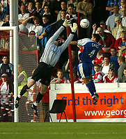 Photo. Andrew Unwin<br /> Rotherham v Millwall, Nationwide League Division One, Millmoor Lane, Rotherham 11/10/2003.<br /> Millwall's Tim Cahill (r) competes in the air against Rotherham goalkeeper, Mike Pollitt (l).