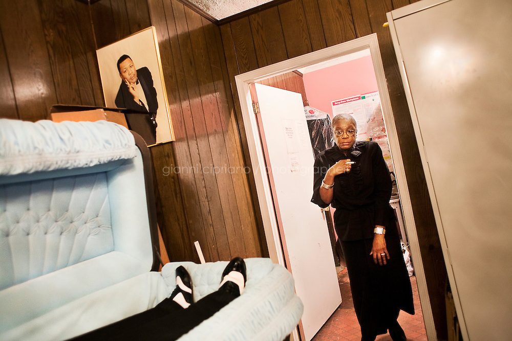 Harlem, New York, USA - April 21. Eleanor Kennedy, a staff member of the Isaiah Owens Funeral Home, watches the corpse of Isaiah Owens' cousin, Mr Parks, as she steps out of the office on April 21, 2008 in Harlem, New York, USA.