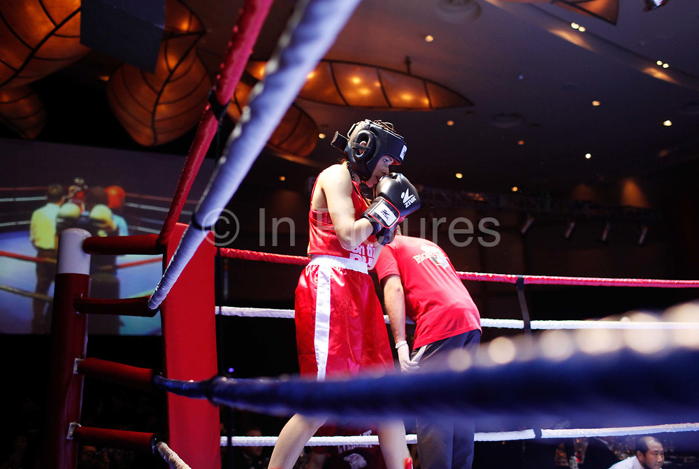 A contestant readies herself before a bout at the Brawl on the Bund event on Saturday, 11 December 2010. The event features 7 pairs of amateur boxers selected from Shanghai's expatriate community.