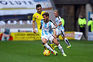 Martin Cranie of Huddersfield Town gets away from Lewis Cook of Leeds united. Skybet football league Championship match, Huddersfield Town v Leeds United at the John Smith's Stadium in Huddersfield, Yorks on Saturday 7th November 2015.<br /> pic by Chris Stading, Andrew Orchard sports photography.