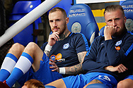 Peterborough United midfielder Marcus Maddison (21) and Peterborough United midfielder George Cooper (19) on the bench before the EFL Sky Bet League 1 match between Peterborough United and Portsmouth at London Road, Peterborough, England on 15 September 2018.
