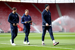 Tottenham Hotspur's Eric Dier (right) inspects the pitch prior to the beginning of the Premier League match at St Mary's Stadium, Southampton.