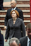 Council Speaker Christine Quinn at the funeral for NYPD Officer Omar Edwards held at Our Lady of Victory in Brooklyn on June 4, 2009..NYPD Officer Omar Edwards posthumusly promoted to the rank of Detective was killed by NYPD Detective Andrew Dunton in a case of friendly fire, when Edwards was takened for a suspect with gun in hand. On Thursday June 4 2009, Officer Omar J. Edwards, 25, was shot by a fellow officer on a Harlem street while in street clothes. He had just finished his shift, and had his service weapon out, chasing a man who had broken into his car, police said. Three plainclothes officers on routine patrol arrived at the scene and yelled for the two to stop, police said. One officer, Andrew Dunton, opened fire and hit Edwards three times as he turned toward them with his service weapon. It wasn't until medical workers were on scene that it was determined he was a police officer.