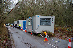 © Licensed to London News Pictures. 12/12/2019. Gerrards Cross, UK. Vehicles and portable cabins line the road at the site of a search operation as the Metropolitan Police Service confirm they are searching woodland in Beaconsfield, Buckinghamshire in connection with the disappearance and murder of Mohammed 'Shah' Subhani. Police have been in the area conducting operations on Hedgerley Lane since Thursday 5th December 2019 and are combing wooded area with specialist officers, assisted by specialist search dogs. Photo credit: Peter Manning/LNP