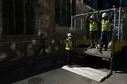 Workmen loading a lorry within street scene of light and shadow in the City of London, England, United Kingdom. (photo by Mike Kemp/In Pictures via Getty Images)