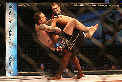 Wade Henderson (Red) attempts to get Bruno Mukulu (Blue) down during the ninth bout of the Extreme Fighting Championships, EFC 52 held at the Grand West Casino in Cape Town, South Africa on the 5th August 2016<br /> <br /> Photo by:   Shaun Roy / Real Time Images