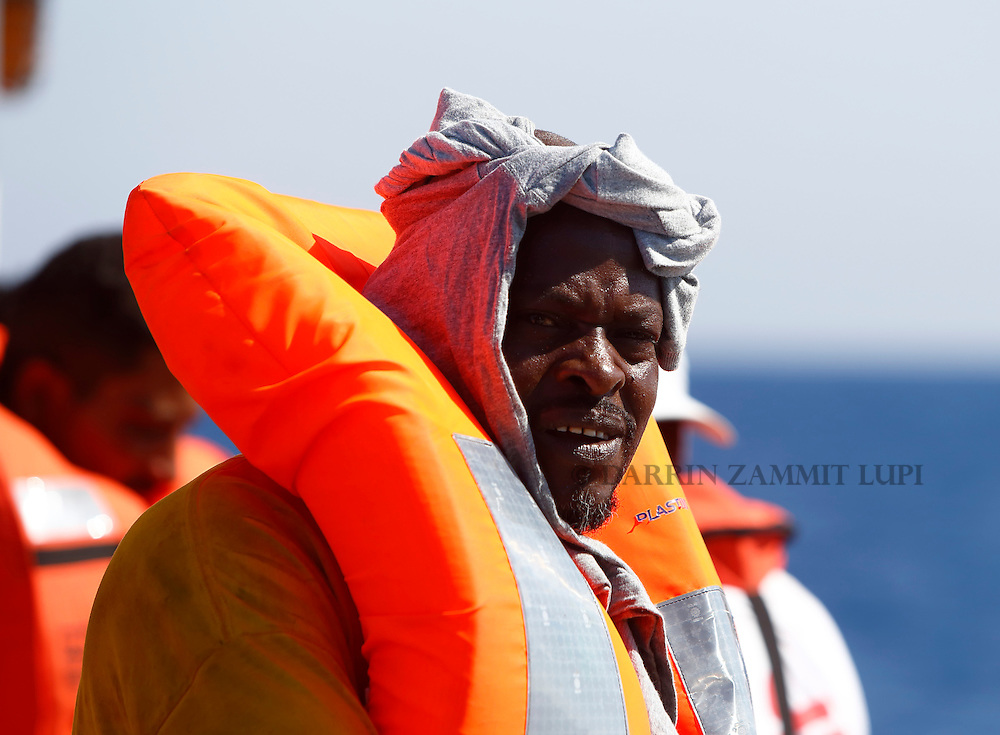 A migrant stands on the upper deck of the Migrant Offshore Aid Station (MOAS) ship MV Phoenix after being rescued from an overloaded wooden boat 10.5 miles (16 kilometres) off the coast of Libya August 6, 2015.  An estimated 600 migrants on the boat were rescued by the international non-governmental organisations Medecins san Frontiere (MSF) and MOAS without loss of life on Thursday afternoon, according to MSF and MOAS, a day after more than 200 migrants are feared to have drowned in the latest Mediterranean boat tragedy after rescuers saved over 370 people from a capsized boat thought to be carrying 600.<br /> REUTERS/Darrin Zammit Lupi <br /> MALTA OUT. NO COMMERCIAL OR EDITORIAL SALES IN MALTA