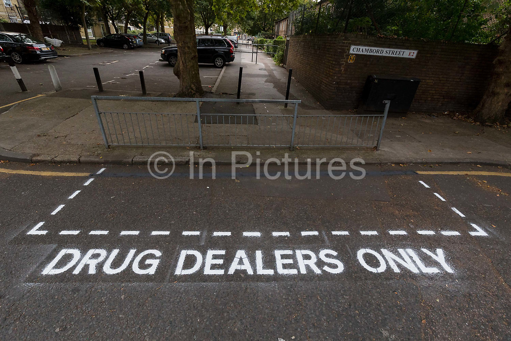 Community activists from the 'Columbia Road Cartel' paint hoax 'Drug Dealers Only' road markings as part of the anti drugs street art campaign in residential streets near Columbia Road in Shoreditch east London on September 16, 2018 to highlight high levels of drug dealing in this part of Tower Hamlets, where the cheapest heroin in Europe can allegedly be purchased. The road signs and markings were commissioned by residents from the Weavers Community Action Group who claim that the police and Tower Hamlets Council are failing to address the growing drugs problem in the area.  (photo by Vickie Flores / In Pictures via Getty Images)