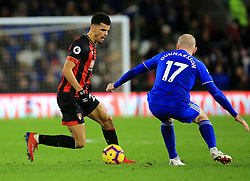 Bournemouth's Dominic Solanke (left) and Cardiff City's Aron Gunnarsson battle for the ball during the Premier League match at the Cardiff City Stadium.
