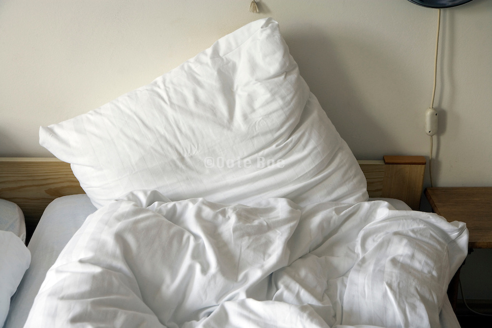 pillow and unmade bed