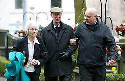 Retited footballer and manager Jack Charlton (centre) and wife Pat Kemp arrive for the funeral service for Gordon Banks at Stoke Minster.