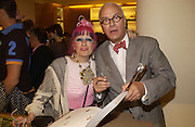 Zandra Rhodes and Manolo Blahnik. Christopher Bailey hosts a party to celebrate the launch of ' The Snippy World of New Yorker Fashion Artist Michael Roberts' Burberry, New Bond St.  London. 19  September 2005. ONE TIME USE ONLY - DO NOT ARCHIVE © Copyright Photograph by Dafydd Jones 66 Stockwell Park Rd. London SW9 0DA Tel 020 7733 0108 www.dafjones.com