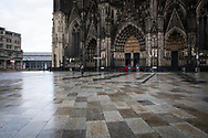 Corona Lockdown, December 16th. 2020. The almost deserted square around Cologne Cathedral, usually visited by thousands of people, Cologne, Germany.<br /> <br /> Corona Lockdown, 16. Dezember 2020. Die fast menschenleere Domplatte, normalerweise von tausenden Menschen besucht, Koeln, Deutschland.
