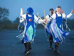 © Licensed to London News Pictures. 1/5/2014. Barr Beacon, Birmingham, UK. Dancing in the dawn. To welcome the first day of May, the Glorishears dance at sunrise on Barr Beacon in Birmingham. Glorishears of Brummagem are women Morris Dancers from the Birmingham area. They perform traditional Cotswold Morris dances. Photo credit : Dave Warren/LNP.