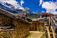 Home to the Naxi people, with buildings are made of stone is the village of Yuhu,  at the foot of the Jade Dragon Snow Mountain. The village was the residence from 1921-1949 of Austrian-American (National Geographic contributor) Joseph Rock, a geographer, linguist and botanist.