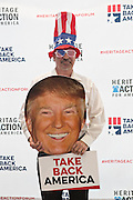 A supporter of billionaire and GOP presidential candidate Donald Trump poses in costume before the start of the Heritage Foundation Take Back America event  September 18, 2015 in Greenville, South Carolina. The event features 11 presidential candidates but Trump unexpectedly cancelled at the last minute.