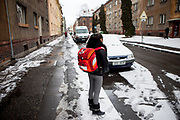 """Rachel Klemparova (9) after school in front of her home in Ostrava. Rachel visits the 4th class at the """"Nadrazni"""" school in Ostrava where Roma and non Roma children are educated together."""