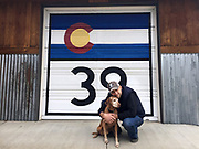 SHOT 5/15/16 5:59:02 PM - Marc Piscotty of Denver, Co. hugs his dog Tanner, a male 12 year-old Vizsla while on a walk in his neighborhood in Denver, Co. (Photo by Marc Piscotty / © 2016)