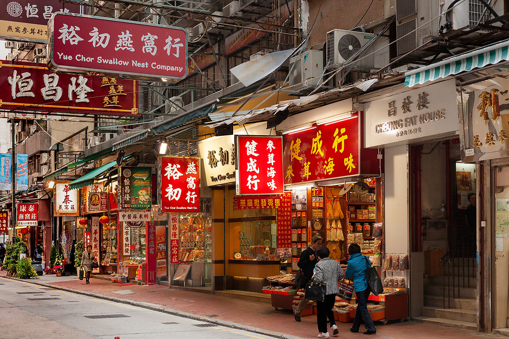 Sheung Wan, Hong Kong Island, Hong Kong, China, Asia - Stores and sings on a commercial street at Western Hong Kong.