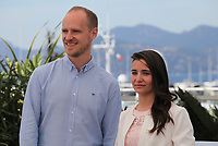 Directors Edward Watts and Waad Al Kateab at For Sama film photo call at the 72nd Cannes Film Festival, Thursday 16th May 2019, Cannes, France. Photo credit: Doreen Kennedy