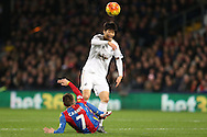 Yohan Cabaye of Crystal Palace challenges Ki Sung-Yueng of Swansea City. Barclays Premier League match, Crystal Palace v Swansea city at Selhurst Park in London on Monday 28th December 2015.<br /> pic by John Patrick Fletcher, Andrew Orchard sports photography.