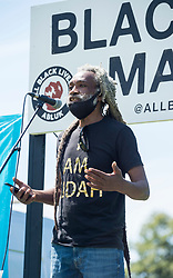 © Licensed to London News Pictures; 12/07/2020; Bristol, UK. JUDAH ADUNBI, also known as RAS JUDAH, a former race relations advisor with Avon and Somerset police who was tasered in the face by police in 2017 in a case of mistaken identity, speaks at a protest rally by All Black Lives Bristol in Eastville Park. The event features a diverse group of speakers including spoken word performance, and representation from black-led businesses, charities and organisations in the city. All Black Lives Bristol is part of All Black Lives UK which is separate from the Black Lives Matter Activist Coalition, and are not affiliated with either Black Lives Matter USA or the political arm of the Black Lives Matter (Activist Coalition) UK who are purported to be affiliated with BLM USA.<br /> Five people behind Bristol's All Black Lives movement organised the protest that made headlines around the world.when Colston's statue was toppled from its plinth, dragged through the city centre and thrown into Bristol Harbour, though they did not organise what happened to the statue that day. The protest on 07 June was in protest for the memory of George Floyd, a black man who was killed on May 25, 2020 in Minneapolis in the US by a white police officer kneeling on his neck for nearly 9 minutes. The killing of George Floyd has seen widespread protests in the US, the UK and other countries. Photo credit: Simon Chapman/LNP.