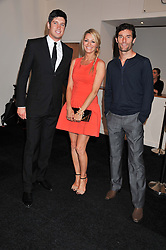 Left to right, VERNON KAY, TESS DALY and F1 driver MARK WEBBER at the F1 Party in aid of Great Ormond Street Hospital Children's Charity held at Battersea Evolution, Battersea Park, London on 4th July 2012.