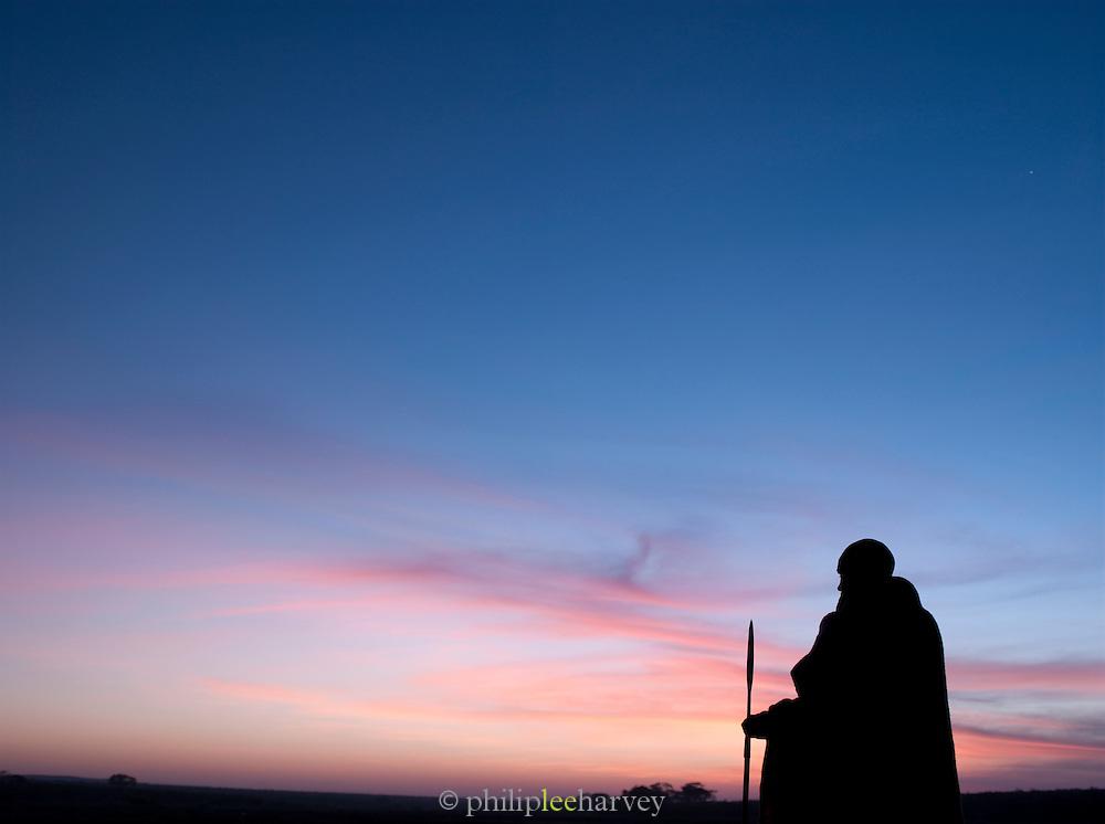Maasai tribesman at sunset in the Maasai Mara, Kenya