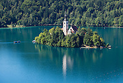 A medieval church was built in the 1400s on glacially formed Lake Bled (Slovene: Blejsko jezero) in the Julian Alps in northwestern Slovenia, Europe. The lake surrounds Bled Island (Blejski otok, the only natural island in Slovenia), upon which stands the Pilgrimage Church of the Assumption of Mary (Slovenian: Cerkev Marijinega vnebovzetja), built in the 1400s and now popular for romantic weddings. Lake Bled hosted the World Rowing Championships in 1966, 1979, 1989, and 2011. The lake is 35 kilometers from Ljubljana International Airport.