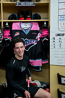 KELOWNA, CANADA - OCTOBER 21: Konrad Belcourt #5 of the Kelowna Rockets tapes his stick for Pink the Rink fundraiser night for the Canadian Cancer foundation on October 21, 2017 at Prospera Place in Kelowna, British Columbia, Canada.  (Photo by Marissa Baecker/Shoot the Breeze)  *** Local Caption ***
