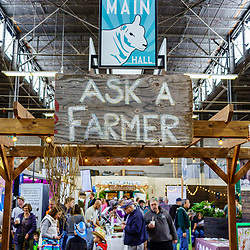 Harrisburg, PA / USA - January 9, 2020: Ask a Farmer is an opportunity for visitors at the Pennsylvania Farm Show to meet farmers and ask questions about farming.