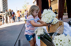 Addison Justice, 4, leaves white flowers on the steps of Boise City Hall Monday, July 2, 2018 on behalf of nine stabbing victims and in the refugee community last Saturday night in Boise, Idaho, USA. Photo by Darin Oswald/Idaho Statesman/TNS/ABACAPRESS.COM
