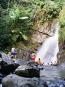 People enjoy cooling off in La Mina Falls, El Yunque Falls, Puerto RIco.