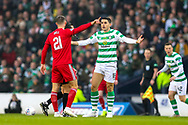 Tomas Rogic (#18) of Celtic protests a foul with Dominic Ball (#21) of Aberdeen during the Betfred Cup Final between Celtic and Aberdeen at Celtic Park, Glasgow, Scotland on 2 December 2018.