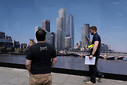 The rear view of a man who is looking at the image of the London skyline which is printed on a construction hoarding on the Southbank, on 10th June 2021, in London, England. (Photo by Richard Baker / In Pictures via Getty Images)