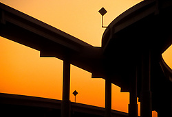 Silhouette of an elevated freeway overpass in Houston Texas at sunset