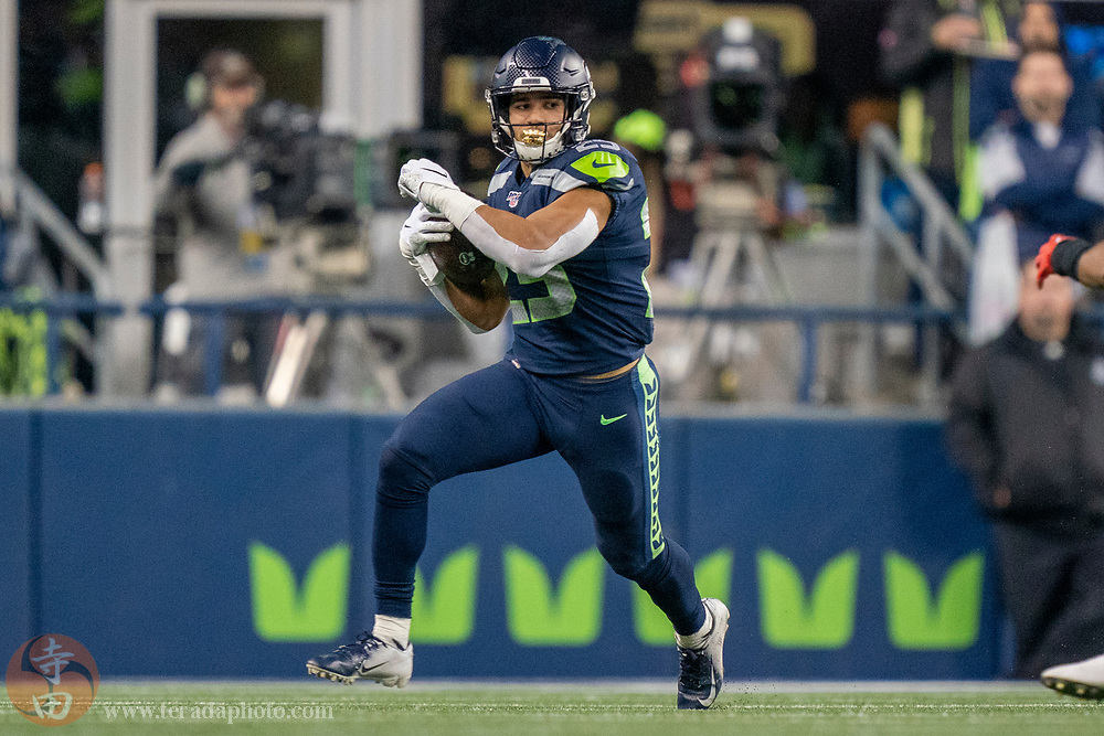 December 29, 2019; Seattle, Washington, USA; Seattle Seahawks running back Travis Homer (25) during the second quarter against the San Francisco 49ers at CenturyLink Field.